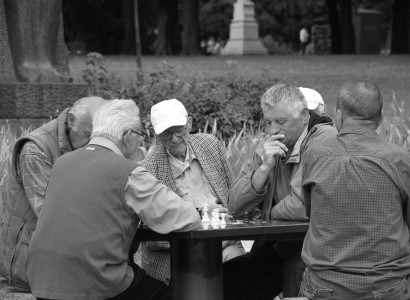old men play chess on a lazy afternoon