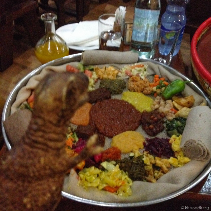 Rex samples an array of curries with injera, a sourdough-risen flatbread with a unique, slightly spongy texture, that is the traditional cuisine of Ethiopia