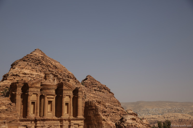 The intricate carvings of the Monastery are a stark contrast to the rough rock that surrounds it.